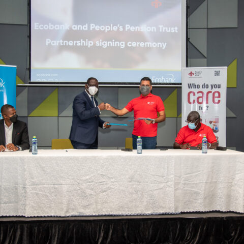People's Pension and Ecobank Heads exchanging the signed agreement.